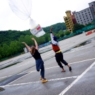 Two volunteers release a balloon. It will travel for three hours at an altitude of roughly 3 to 5KM's high.