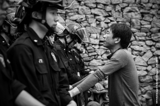 Photo Taken: Saturday May 02nd, 2015 (Insadong, Seoul) The police form a wall to stop a man from passing. The protestor wants to take his message to a President unwilling to hear their pleas.