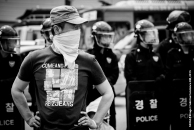 Photo Taken: Saturday May 02nd, 2015 (Insadong, Seoul) One of the organizers looks around to see where the police are moving to and what they may be up to.