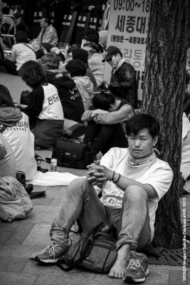 Photo Taken: Saturday May 02nd, 2015 (Insadong, Seoul) A protestor takes a break after a long day of rallying against a government he feels failed him and the victims of the Sewol Ferry disaster.